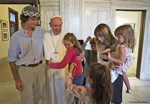 jPope Francis with a family